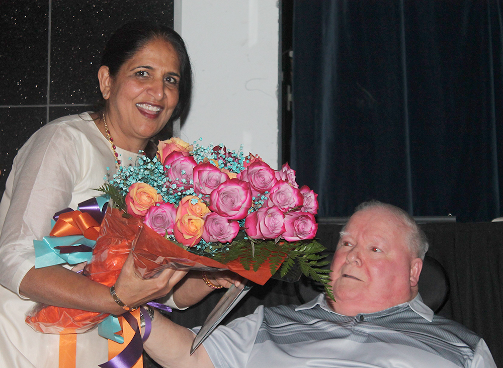 Presenting Flowers at Ravi Dinner St. Joseph's Gala