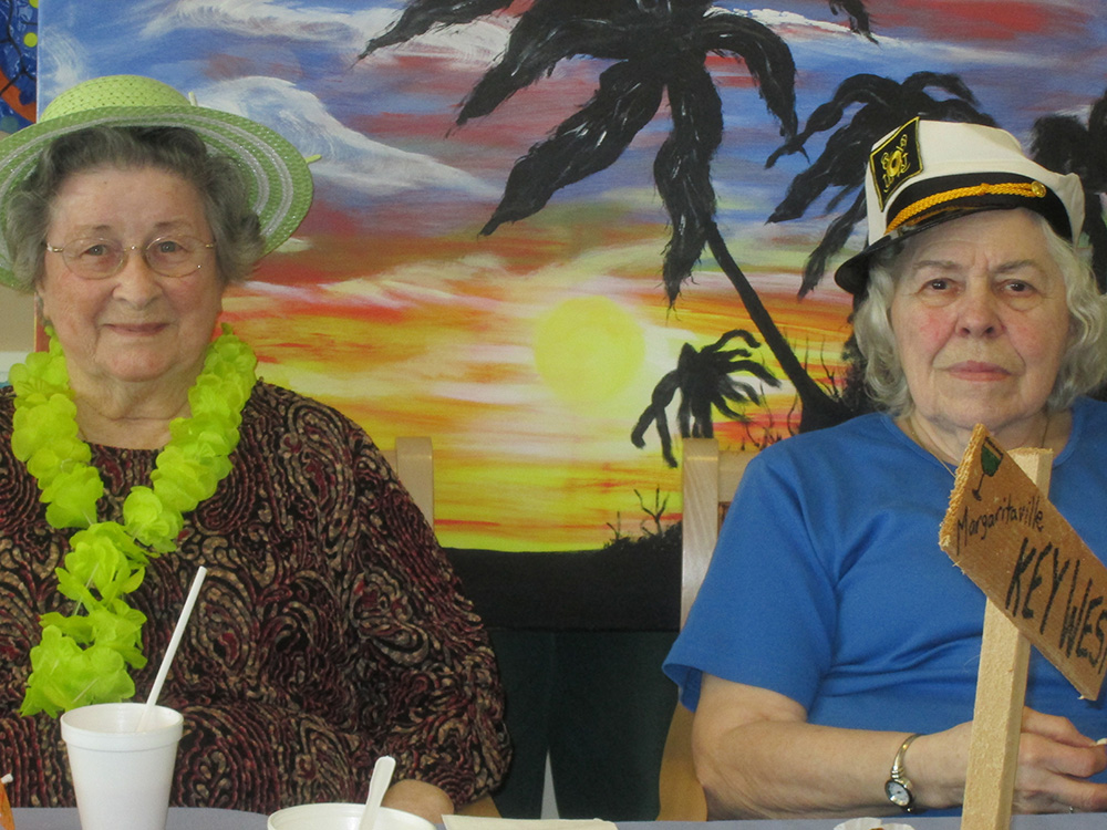 Two residents dressed with hats and leis for for cruise day 2014