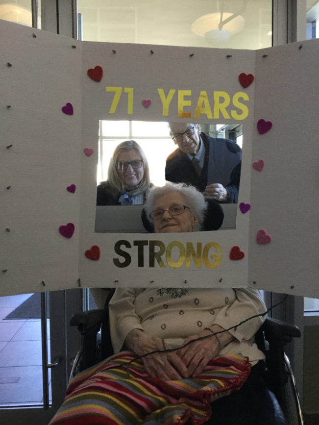 Ida and Clary Gatien with 71 Years Strong Banner
