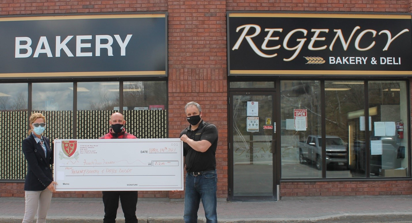 Max Massimiliano, Regency Bakery and Anthony Rocca, Doyle Dodge present a cheque in the amount of $2,200 to Jo-Anne Palkovits, Administrator