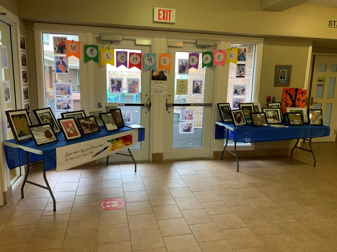 Inside the front doors of St. Joe's Villa displaying the Silent Auction artwork