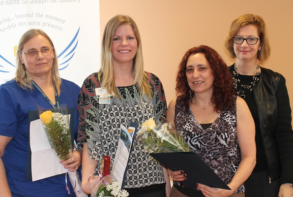 Holding flowers Sisters of St. Joseph of Sault Ste. Marie Awards for Excellence (VSGV)