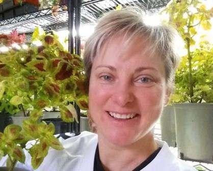 Karen Shlemkevich is pictured with a coleus plant