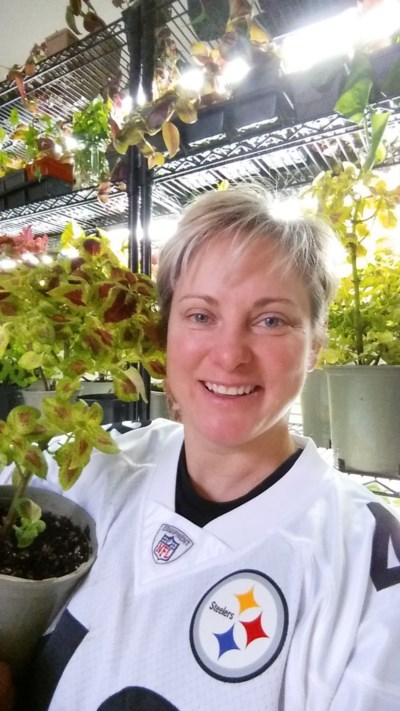 University of Guelph graduate student Karen Shlemkevich is pictured here with a coleus plant