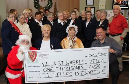 Presentation of cheque Donation from Filles d'Isabelle