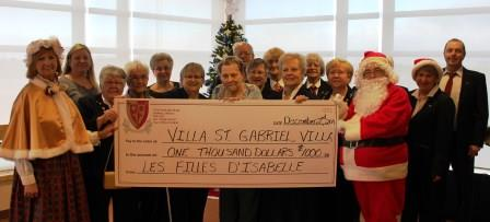 Filles D'Isablle donate to VSGV cheque presentation