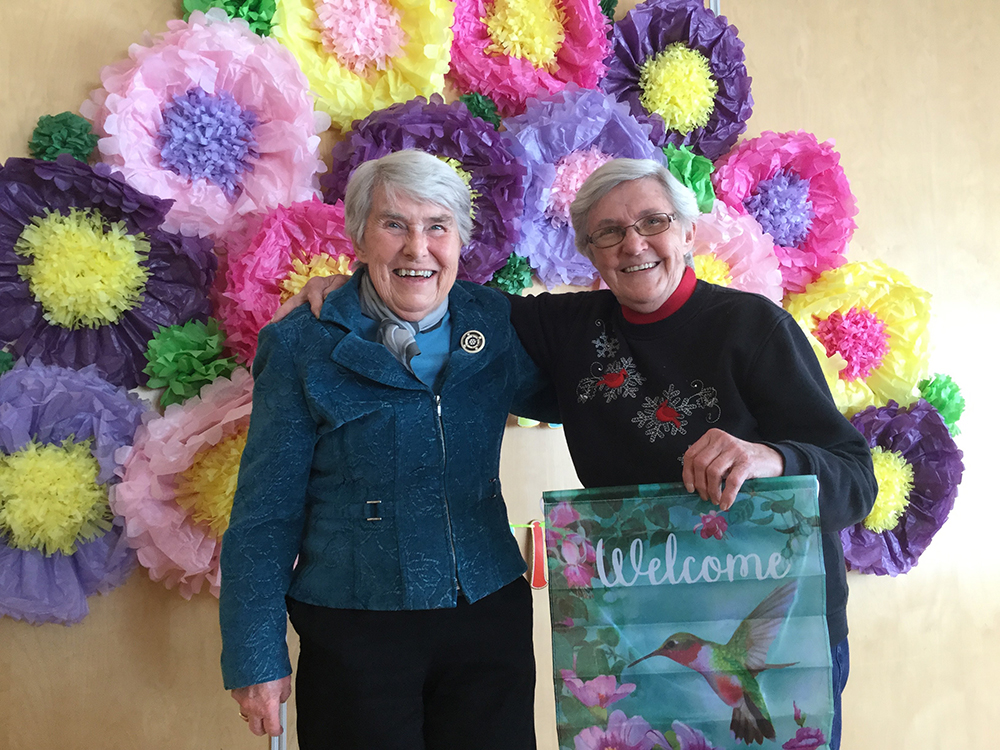 VSGV Residents in front of Flowers