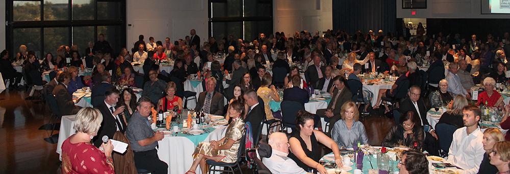 Main crowd seated at tables at St. Joseph's Ravi Dinner Gaga